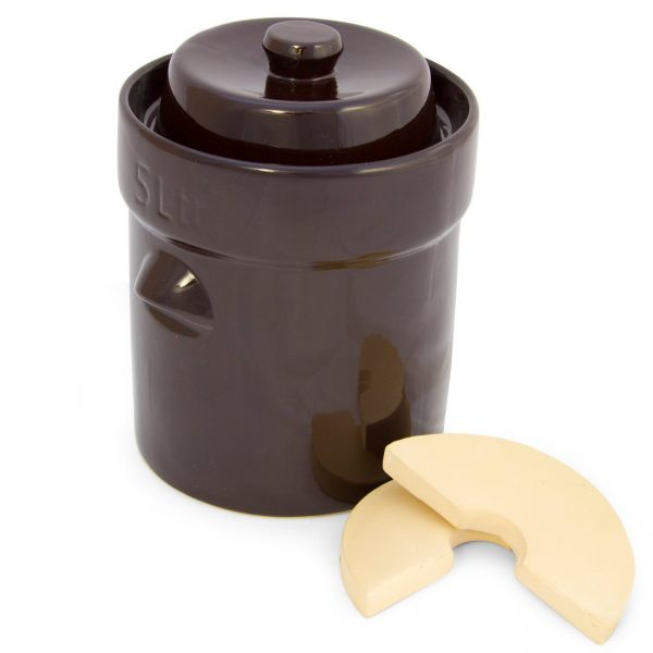 closed lid 5 liter ceramic fermenting crock next to weighting stones