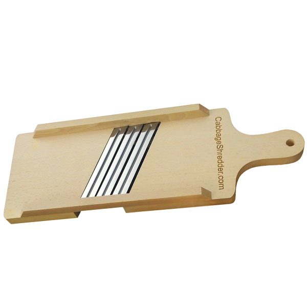 Small wooden cabbage shredder on white background