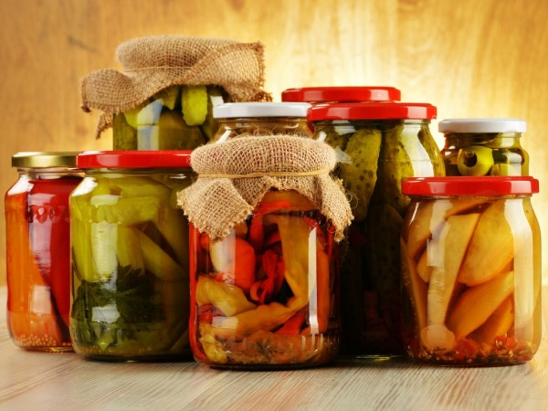 Various fermented vegetables in glass jars