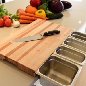 Cutting board with containers by ChopSlide