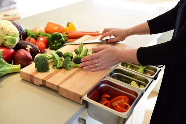 ChopSlide wooden cutting board with food prep containers