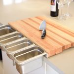 ChopSlide chopping board with stainless steel containers